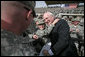 Vice President Dick Cheney greets U.S. troops and poses for pictures Tuesday, March 18, 2008, during a rally at Balad Air Base, Iraq. White House photo by David Bohrer