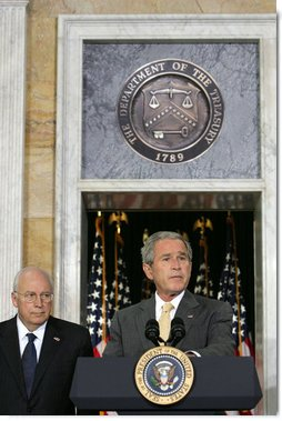 """President George W. Bush stands with his economic advisors as he delivers a statement to the press Wednesday, Aug. 8, 2007, at the U.S. Department of Treasury in Washington, D.C. """"We discussed our thriving economy and what we need to do to keep it that way,"""" said President Bush. """"We care a lot about whether our fellow citizens are working, and whether or not they've got money in their pockets to save, spend, or invest as they see fit."""" White House photo by Chris Greenberg"""
