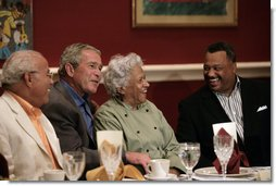 President George W. Bush shares a moment with restaurant owner Leah Chase, center, and fellow dinner guests Dr. Norman Francis, president of Xavier University of Louisiana, left, and Reverend Fred Luter, right, during a dinner with Louisiana cultural and community leaders Tuesday evening, Aug. 28, 2007, at Dooky Chase's restaurant in New Orleans. President Bush and Mrs. Laura Bush are visiting New Orleans and the Gulf Coast region on the second anniversay of Hurricane Katrina. White House photo by Shealah Craighead