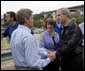 President George W. Bush shakes hands with Minnesota Senator Norm Coleman, left, and greets Senator Amy Klobuchar, (center), , at the conclusion of the President's visit Saturday, Aug. 4, 2007, to the site of the I-35W bridge collapse in Minneapolis. White House photo by Chris Greenberg