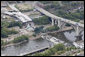 President George W. Bush, aboard Marine One, takes an aerial survey of the Interstate 35W bridge collapse in Minneapolis, Saturday, Aug. 4, 2007. President Bush said he would work to help local, state and federal authorities to cut through the red tape to get the bridge rebuilt as soon as possible. White House photo by Chris Greenberg