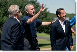 President George W. Bush waves to the press as he welcomes President Nicolas Sarkozy of France to Walker's Point Saturday, August 11, 2007, in Kennebunkport, Maine. White House photo by Shealah Craighead