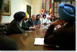 """President Bush meets with Sikh Community Leaders in the White House Roosevelt Room to discuss,""""the common commitment to make sure that every American is treated with respect and dignity. We're all Americans, bound together by common ideals and common values,"""" said the President during his remarks. White House photo by Tina Hager."""