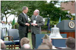 """Stories were exchanged and as President Bush presented Australian Prime Minister Howard with the bell from the U.S.S. Canberra at a ceremony commemorating 50 years of military alliance. """"The President had received word of an exceptional action in battle by the Australian Navy, which were steaming alongside American vessels at Guadalcanal. His Majesty's Australian ship Canberra did not survive the battle, disappearing into the depths where she rests today,"""" explained the President. White House photo by Tina Hager."""