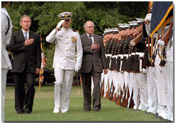 With their hands over their hearts, President Bush and Australian Prime Minister John Howard perform a military pass and review at the Washington Navy Yard Sept. 10, 2001. Commemorating 50 years of military alliance, the President and Prime Minister spoke to assembled military personnel, shared lunch and spoke privately in the Oval Office. White House photo by Tina Hager.