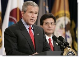 Attorney General Alberto Gonzales looks on as President Bush delivers remarks Monday, Feb. 14, 2005, during Mr. Gonzales's ceremonial swearing in.  White House photo by Paul Morse