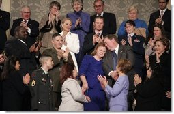 """During the State of the Union Address Wednesday, Feb. 2, 2005, Janet and William Norwood, center, comfort each other as President Bush talks about their son, Marine Corps Sergeant Byron Norwood of Pflugerville, Texas, who died during the assault on Fallujah. """"Ladies and gentlemen, with grateful hearts, we honor freedom's defenders, and our military families, represented here this evening by Sergeant Norwood's mom and dad, Janet and Bill Norwood,"""" President Bush said during his speech at the U.S. Capitol.   White House photo by Eric Draper"""