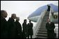 German Chancellor Gerhard Schroeder, fourth from left, and others wait on the tarmac as arriving U.S. President George W. Bush deplanes Air Force One at Rhein-Main Air Base in Frankfurt, Germany. White House photo by Eric Draper