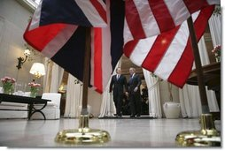 President George W. Bush and Prime Minister Tony Blair of the United Kingdom walk together after addressing the press at the Ambassador's Residence in Brussels, Belgium, Tuesday Feb. 22, 2005.