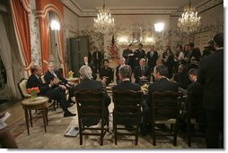 Attending a bilateral meeting, Presidents George W. Bush and Jacques Chirac of France address the press at the Ambassador's Residence, Brussels, Belgium, Monday, Feb. 21, 2005.  White House photo by Eric Draper