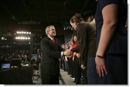 """President George W. Bush greets audience members after holding a conversation about the strengthening of Social Security at ExpoPark in Great Falls, Mont., Feb., 3, 2005. """"I believe you ought to be able -- allowed to take some of your own money, payroll taxes, and set up a personal retirement account, on a voluntary basis,"""" said the President in his remarks.  White House photo by Eric Draper"""