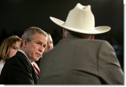 President George W. Bush listens to retired senior citizen Leo Keller during a Town Hall meeting about the strengthening of Social Security at the Montana ExpoPark in Great Falls, Mont., Thursday, Feb. 3, 2005.  White House photo by Eric Draper