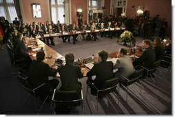 President George W. Bush participates in a Wednesday, Feb. 23, 2005, roundtable discussion with young professionals at the Electoral Palace in Mainz, Germany.   White House photo by Eric Draper