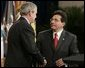 Attorney General Alberto Gonzales receives congratulations from President Bush during ceremonies Monday, Feb. 14, 2005, marking Mr. Gonzales's new post. White House photo by Paul Morse.