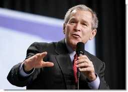 President George W. Bush leads the discussion on stage during a Conversation on Strengthening Social Security at the Pease International Tradeport Airport, Wednesday, Feb. 16, 2005.  White House photo by Eric Draper