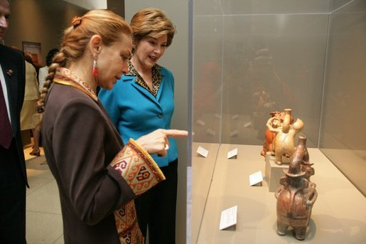 """Elaine Karp de Toledo, First Lady of Peru, explains artifacts on display to Laura Bush during a visit to view the exhibit """"Peru: Indigenous and Viceregal,"""" at the National Geographic Society Friday, Feb. 25, 2005 in Washington, D.C. Also present is John Fahey, Jr., President and CEO of National Geographic Society. White House photo by Susan Sterner"""