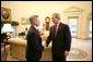 President George W. Bush greets Veterans Affairs Secretary Jim Nicholson in the Oval Office, Friday, Feb. 18, 2005. Secretary Nicholson was sworn into office Feb. 1, 2005. White House photo by Eric Draper