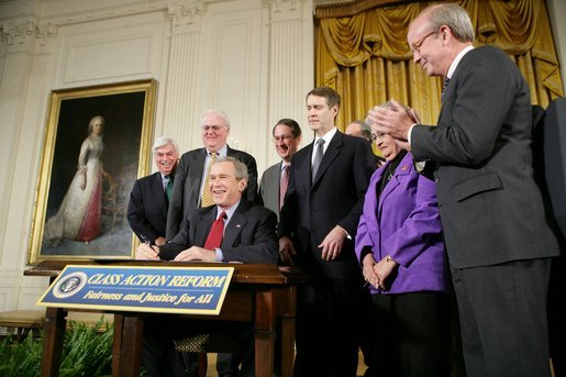 President George W. Bush signs S. 5, the Class Action Fairness Act of 2005, during a ceremony in the East Room, Friday, Feb. 18, 2005. White House photo by Eric Draper