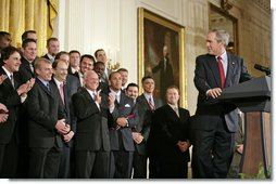 President George W. Bush looks back to MVP David Eckstein during his remarks honoring the St. Louis Cardinals, who won the 2006 World Series Championship, in the East Room Tuesday, Jan. 16, 2007. White House photo by Eric Draper