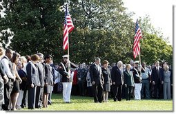 Honoring the memory of those who died during terrorist attacks on this day two years ago, President George W. Bush, Laura Bush, Vice President Dick Cheney and Lynne Cheney stand with White House staff for a moment of silence on the South Lawn 8:46 a.m., Thursday, Sept. 11, 2003.  White House photo by David Bohrer