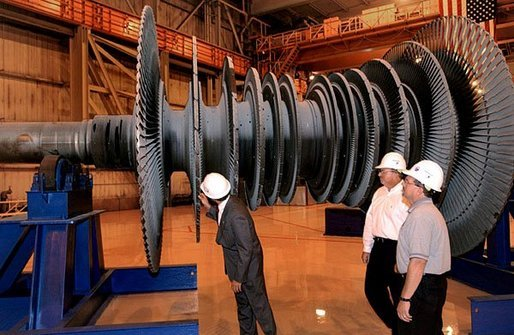 President George W. Bush tours the Detroit Edison's Monroe Power Plant in Monroe, Mich., Monday, Sept. 15, 2003. At the plant, the President viewed modernizing efforts and discussed how the administration is improving New Source Review regulations. The changes will provide increased flexibility and ensure that air pollution will not be increased when plants maintain and replace worn-out equipment. White House photo by Tina Hager.