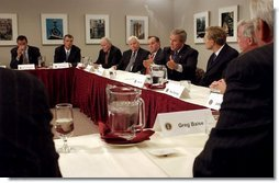 "President George W. Bush discusses the economy with local business leaders in Chicago Tuesday, Sept. 30, 2003. ""The thing I'm concerned about is people being able to find a job. We put the conditions in place for good job creation, but I recognize there's still people who want to work that can't find a job,"" said the President during his remarks after the meeting. ""And we're dedicated to hearing the voices of those folks and working hard to expand our economy.""  White House photo by Tina Hager"