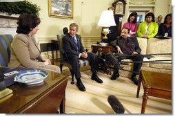 President George W. Bush meets with senior Iraqi officials in the Oval Office Monday, Sept. 22, 2003. They are Nasreen Barwari, Minister of Public Works, left, and Dr. Aiham Alsammarae, Minister of Electricity.  White House photo by Eric Draper