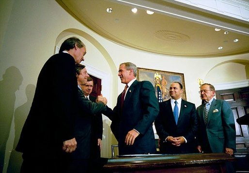 President George W. Bush signs the Do Not Call Registry in the Roosevelt Room Sept. 29, 2003. Pictured with the President are, from left, Rep. Edward Markey, D-Mass.; Rep. Fred Upton, R-Mich.; Federal Trade Commission Chairman Timothy Muris; Rep. Billy Tauzin, R-La. (behind President Bush); Federal Communications Commission Chairman Michael Powell; and Sen. Ted Stevens, R-Alaska. White House photo by Eric Draper.