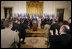 El Presidente George W. Bush acepta el aplauso de legisladores, funcionarios del gobierno e invitados el martes, 2 de agosto en el East Room de la Casa Blanca, en la ceremonia en la que se promulgó la CAFTA Implementation Act.