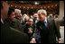 El Presidente George W. Bush les da la mano a miembros de la audiencia tras sus declaraciones ante la Cámara de Comercio Hispana de los Estados Unidos sobre la política con respecto al Hemisferio Occidental el lunes, 5 de marzo de en Washington, D.C. Foto por Paul Morse de la Casa Blanca.