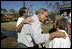 """President Bush spends time with local residents during a walking tour of hurricane damage in Pensacola, Fla., Sept. 19, 2004. Talking with first responders about available aid, the President said, """"But the governors and I fully understand there are people inland who have been affected; there are people in rural Alabama, small-town Alabama whose lives have been turned upside down by this storm, as well; people in rural Florida who have been affected by this storm,"""" said the President in Orange Beach, Ala., Sept. 19, 2004."""