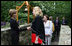 Mrs. Laura Bush greets the directors of Presidential Libraries Wednesday, June 4, 2008, at the entrance to Camp David's Evergreen Chapel in Thurmont, Maryland. Mrs. Bush shakes hands with Ms.Nancy Smith, Director of the National Archives' Presidential Material Staff in Alexandria, VA.