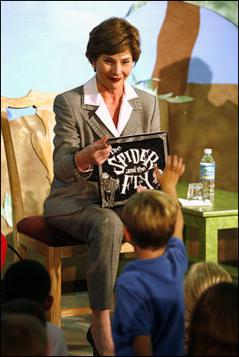 """Mrs. Laura Bush calls on a young member of the audience to speak after she finished reading the book, """"The Spider and the Fly"""" by Mary Howitt, illustrated by Tony DiTerlizzi, during a visit to the West Palm Beach Public Library in West Palm Beach, Fla., Friday, Oct. 27, 2006. The Library began its reading room in a congregational church in 1894, and has grown to have over one hundred-thousand books in their collection."""