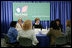 """Mrs. Laura Bush is joined by U.S. Department of Education Secretary Margaret Spellings at a roundtable discussion with Ohio teachers during """"Celebrating Teachers"""" week, Tuesday, May 2, 2006 at the Thurber Center in Columbus, Ohio, highlighting the importance of teachers in children's lives. Moderator of the discussion is Deepa Ganschinietz, far right, the 2006 Ohio Teacher of the Year."""