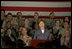"Mrs. Laura Bush addresses American troops Thursday, Oct. 25, 2007, at Ali Al Salem Air Base near Kuwait City. ""With your courage and compassion, you show that the United States military is one of the greatest forces for good in the world,"" Mrs. Bush told the troops. ""And I hope you know that we pray... for an end to the violence everywhere so that future generations can grow up in a world at peace -- a world that you shaped."""