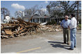 Vice President Dick Cheney talks with Mayor Greg Warr as they take a walking tour of a Gulfport, Mississippi neighborhood which was damagedrecently byHurricane KatrinaThursday, September 8, 2005.
