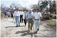 Vice President Dick Cheney walks with a resident of a Gulfport, Mississippi neighborhood Thursday, September 8, 2005. The area was damaged by Hurricane Katrina, which hit both Louisiana and Mississippi on August 29th. Mrs. Cheney and Mayor Greg Warr are also shown walking.