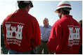 Vice President Dick Cheney speaks with members of the US Army Corps of Engineers personnelwhile taking a tour of the 17th Street levee repair operations in New Orleans, Louisiana Thursday, September 8, 2005.