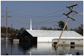 A church in New Orleans, Louisiana is submerged by floodwaters that were caused by the effects of Hurricane Katrina Thursday, September 8, 2005. The hurricane hit both Louisiana and Mississippi on August 29th.