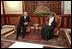 Vice President Dick Cheney meets with Sultan Qaboos in Salalah, Oman, March 14, 2002.