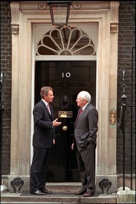 Standing in front of Prime Minister Tony Blair's residence, Number 10 Downing Street, Vice President Dick Cheney shares some final words before departing London March 11, 2002.