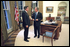 President George W. Bush meets with his new Director of Homeland Security Tom Ridge in the Oval Office shortly before swearing Mr. Ridge in for the position at a White House ceremony Monday, Oct. 8.