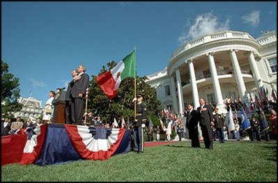 President Bush pledges allegiance during the playing of the National Anthem as Mexican President Vicente Fox stands at attention during the State Arrival Ceremony on the White House South Lawn Sept. 6.