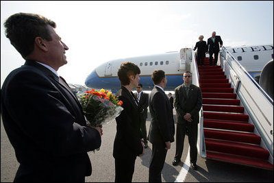 U.S. and Lithuanian officials line up on the tarmac to greet Vice President Dick Cheney and his wife, Lynne Cheney, upon their arrival Wednesday, May 3, 2006 to Vilnius, Lithuania. The Vice President's visit to Vilnius is the first stop in a three-nation, five-day trip that includes bilateral meetings with leaders of the Baltic and Black Sea regions at the Vilnius Conference 2006.
