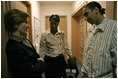 """Laura Bush speaks with Kenyatta """"Ken"""" Thigpen, his girlfriend Jewell Reed and their three-year-old son, Kevion, during a visit to the Rosalie Manor Community and Family Services center in Milwaukee, Wis., Tuesday, March 8, 2005. Mrs. Bush credits a New York Times article by Jason DeParle about Mr. Thigpen's determination to be a responsible father with bringing her attention to the needs of boys and young men."""