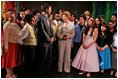 """Laura Bush meets members of the Will Power to Youth program after watching their rendition of """"Romeo and Juliet"""" at the Shakespeare Festival/LA in Los Angeles April 26, 2005. The program recruits children living below the poverty level to create their own versions of Shakespeare's plays, while paying them for their work and offering tutoring opportunities."""