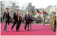 Prior to the inauguration of Afghanistan President Hamid Karzai, Vice President Dick Cheney and his wife, Lynne, and U.S. Ambassador to Afghanistan Zalmay Khalilzad, second on left, attend a welcoming ceremony at the Presidential Palace in Kabul, Afghanistan, Dec. 7, 2004.