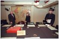 Vice President Dick Cheney and Lynne Cheney tour Winston Churchill's Cabinet War Room in London March 11, 2002. Sitting at the center chair in this underground bunker, Prime Minister Churchill met with his advisors and commanded England's forces. Shortly after Pearl Harbor, the Prime Minister took a risky journey to meet with President Roosevelt in Washington, D.C., and address Congress Dec. 26, 1941. The two leaders worked closely throughout the war, often in secret, to coordinate Allied Forces.