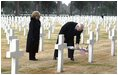 Vice President Dick Cheney places a rose on the grave of Wyoming solider Sgt. John Vannoy while touring the Sicily-Rome American Cemetery with his wife, Lynne, in Nettuno, Italy Jan. 26, 2004. The cemetery inters those who gave their life for the liberation of Italy during World War II.