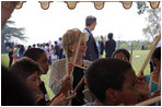 Lynne Cheney participates in a drumming activity with a group of fourth graders from local Fairfax County public schools during a Constitution Day 2005 celebration at George Washington's Mount Vernon Estate Friday, September 16, 2005. The event celebrates the anniversary of the signing of the U.S. Constitution 218 years ago.